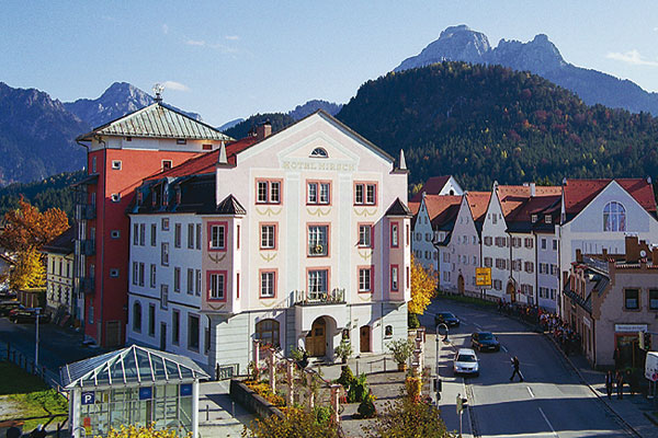 View of the Hirsch Hotel in Füssen with 'Säuling' mountain in the background