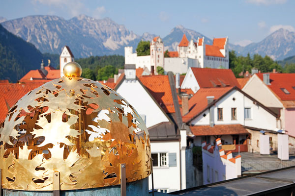 Panoramic view from the roof terrace over Füssen, 'Hohes Schloss' castle and the mountains