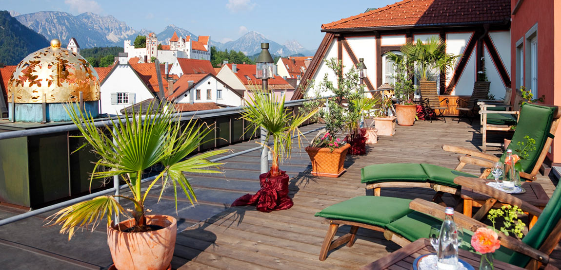 Stunning view from the roof terrace of Hirsch Hotel over Füssen and the Algovian Alps
