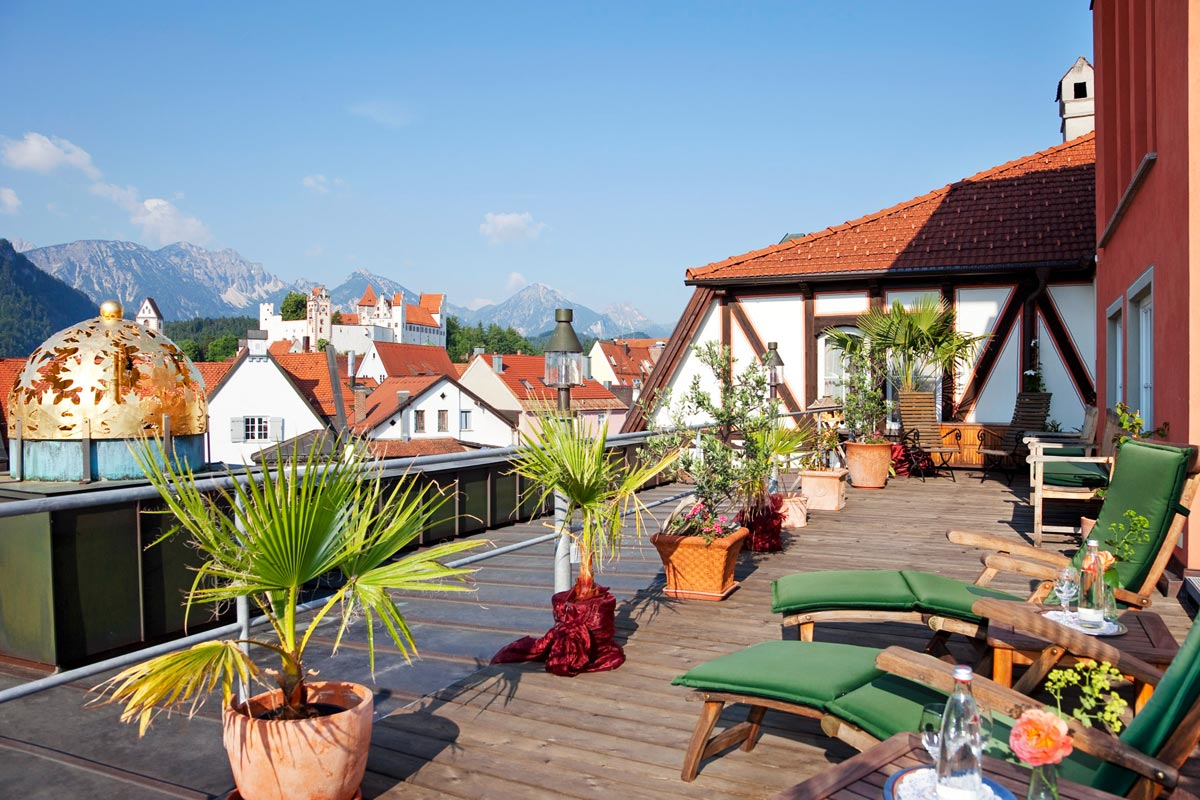View from the roof terrace over Füssen and the alpine mountain range