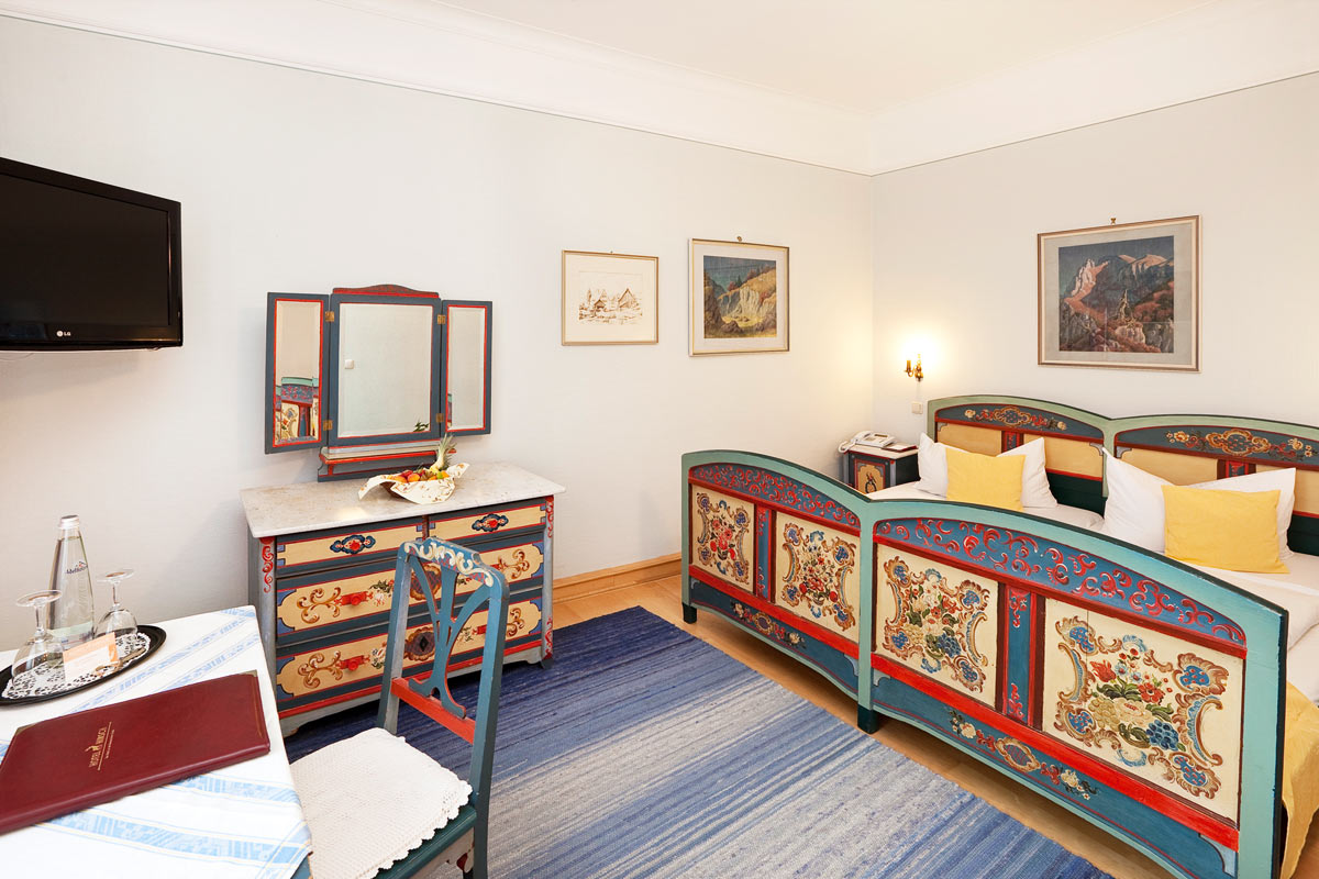 Bavarian double room with rustic furniture like King Ludwig