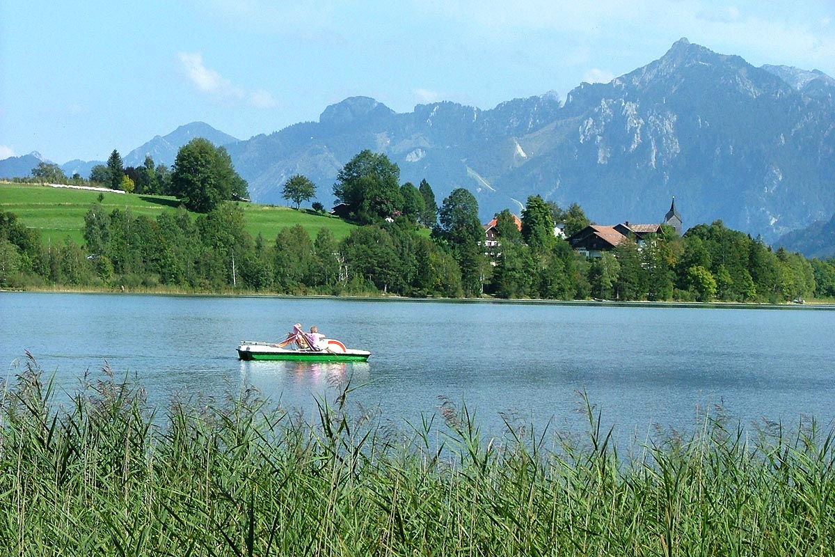 The 'Weissensee' lake with 'Tegelberg' mountain in the background